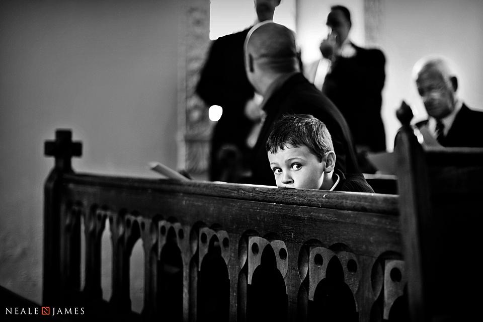 Boy in church at St Nicholas Wasing Park