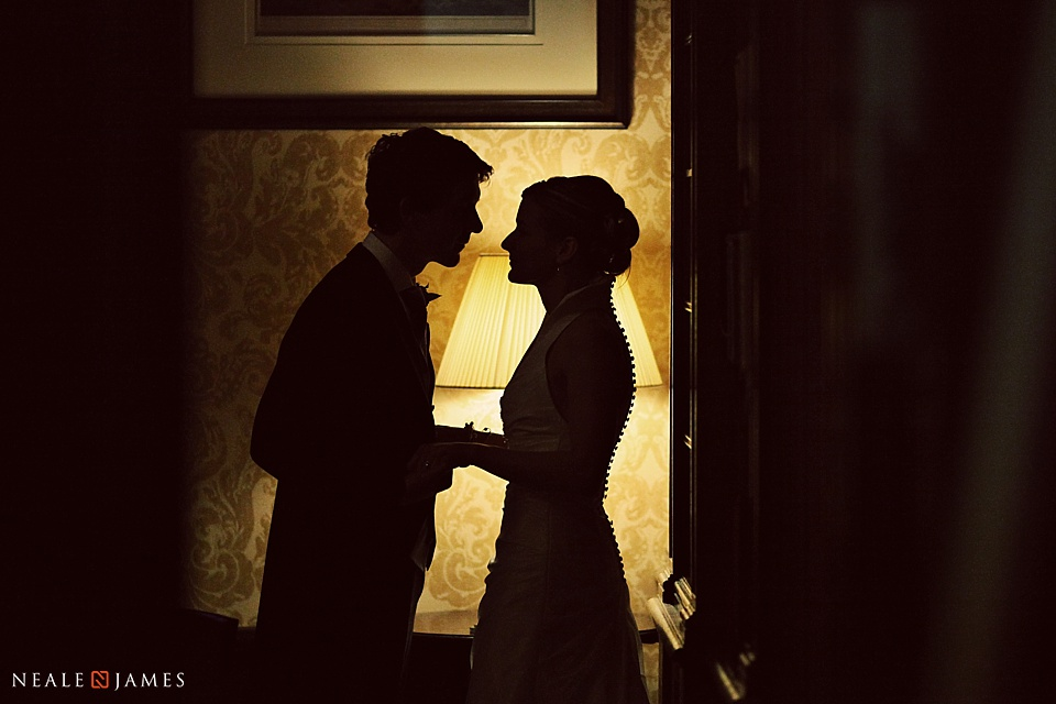 Colour silhouette photo of bride and groom
