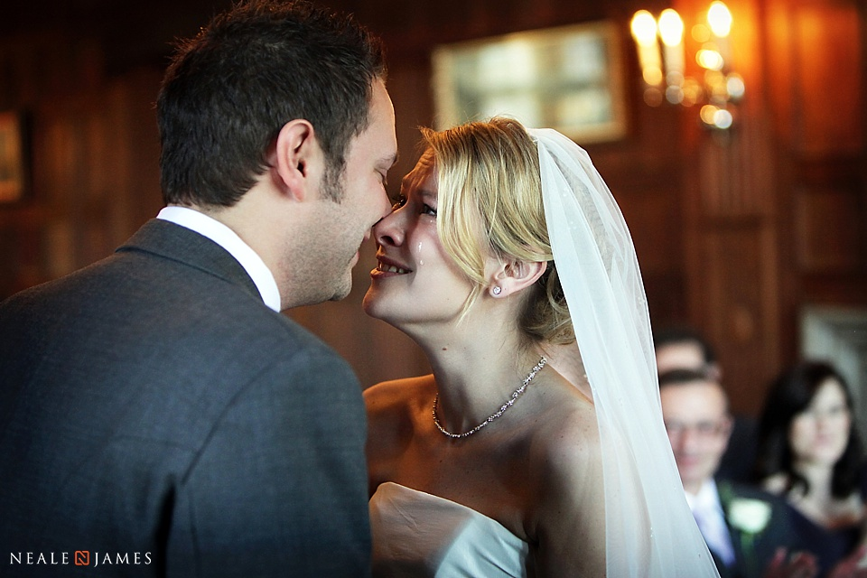 Colour photo of bride and groom kissing