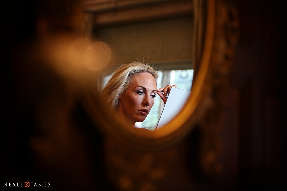 Bridal makeup in mirror photo