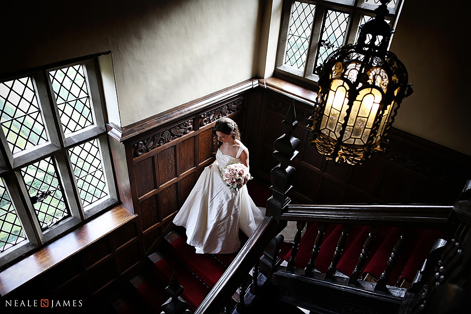 Bride walking to her wedding at Great Fosters